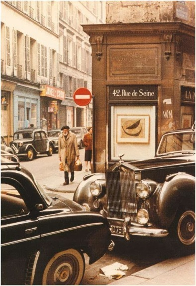 Loaded down with groceries, my apartment should be close by; Paris in 1950s.