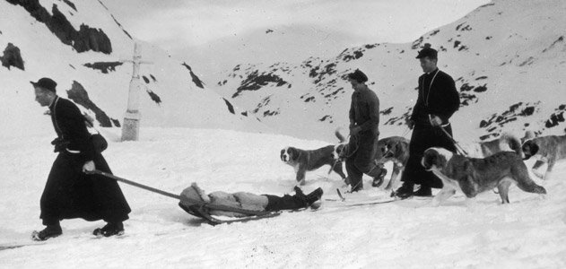 St Bernards and monks rescuing skiers in the Swiss Alps in the 1950s.