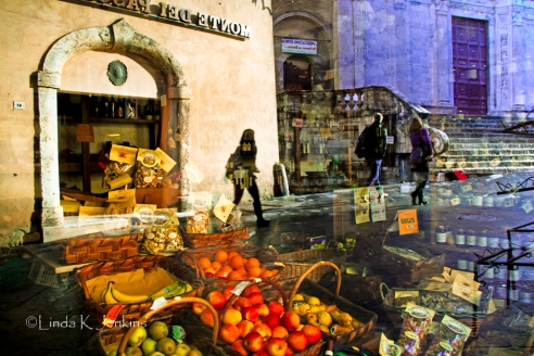 Gazing into a Montepulciano fruit and vegetable store I noticed the reflections of the people